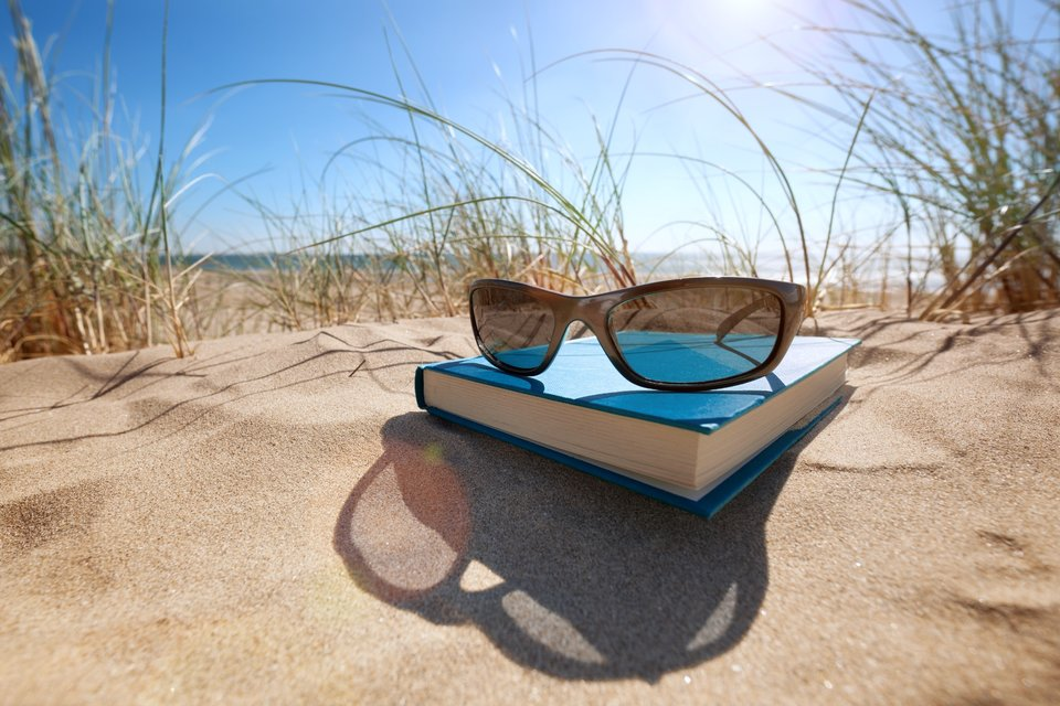 sunglasses on a book