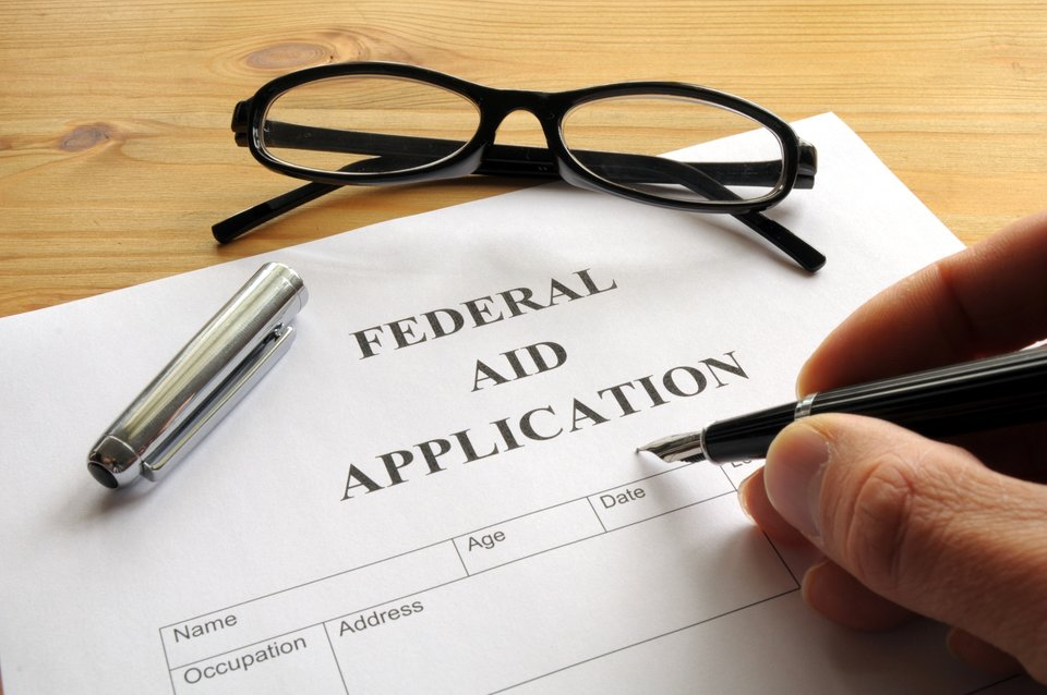 Man filling out Financial Aid form