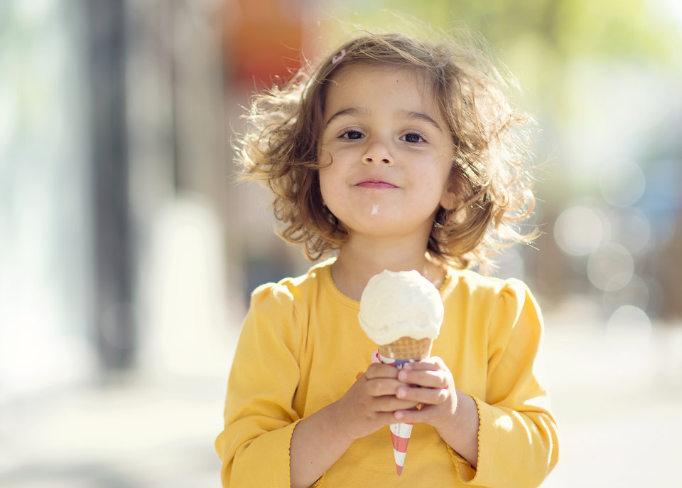 Smug little girl with her ice cream cone