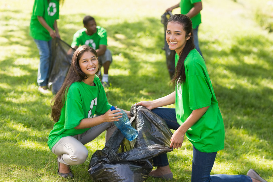 Students volunteering to clean a park